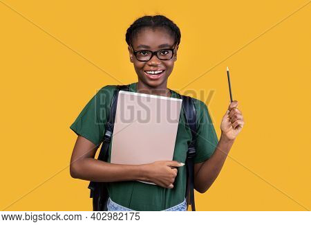 I Have Idea. Happy Creative African Student Woman Holding Pencil Having Inspiration Standing With Bo