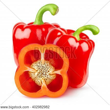 Isolated Bell Peppers. Two Whole Red Peppers And A Slice With Seeds Isolated On White Background