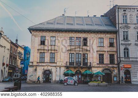 Krakow, Poland - October, 2015: Street With Historical Houses In Krakow Old Town. Handsome Elegant H
