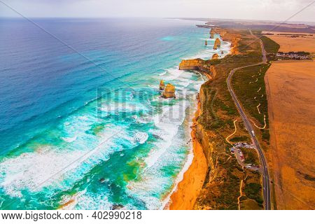 The Twelve Apostles are a group of limestone rocks in the Pacific Ocean near the coast. Australia. Aerial view. Great Ocean Road. Helicopter flight over the scenic Pacific coastline.