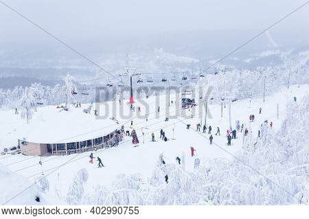Perm Krai, Russia - January 02, 2021: End Station Of The Ski Lift And Many Skiers On The Top Of The