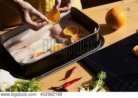 Woman Prepares Cod Fillets In The Oven. Seafood. Healthy Eating. Natural Light. Selective Focus.