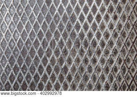 Grunge Steel Floor Plate With Embossed Diamond Pattern Background