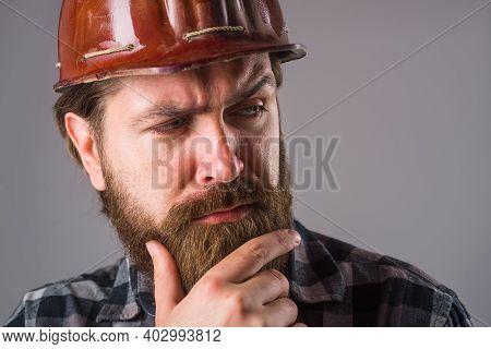Worker In Helmet. Portrait Of Worker In Hardhat. Bearded Worker. Close Up Portrait Of Tired Worker