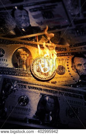 Bitcoin Btc Cryptocurrencies In Flame On Dollars. Concept Falling Crashing.