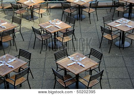 Wood tables and chairs set for lunch