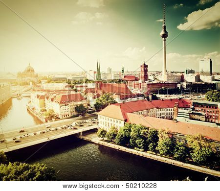 Berlin, Germany rooftop view on Television Tower, Berlin Cathedral, Rotes Rathau and the River Spree. Major landmarks retro, vintage style. poster