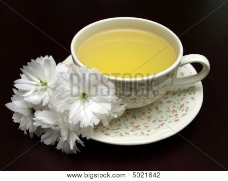 Spring Floral Tea On A Dark Background