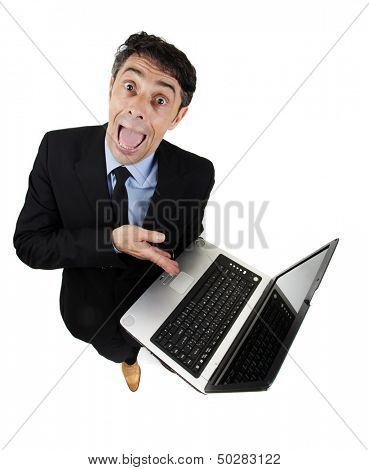 Persuasive garrulous businessman pointing to his computer with his hand as he explains and cajoles trying to win the argument, high angle humorous isolated on white poster