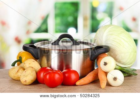 Ingredients for cooking soup on table in kitchen poster