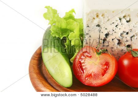 blue stilton cheese and tomatoes on wooden dish poster
