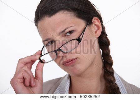 Businesswoman taking off her glasses.
