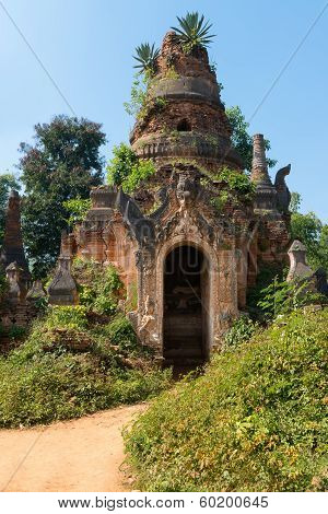 Ruins of ancient Burmese Buddhist pagoda Nyaung Ohak in the village of Indein on Inlay Lake in Shan State Myanmar (Burma). poster