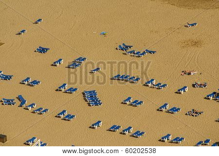 A Group Of Sunbeds In The Beach Of Benidorm