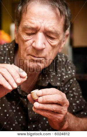 Man With Small Pill And Case