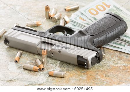 Wad Of 100 Dollar Bills With A Gun And Bullets