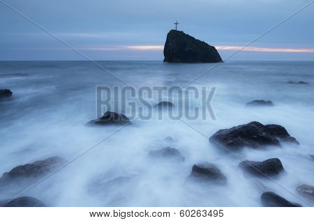 Seascape with rock with a cross. Long exposure. Rock St. phenomena, Crimea, Ukraine, Europe
