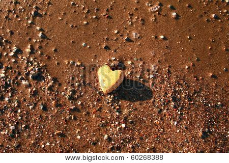 Naturally Heart Shaped Stone On Sand