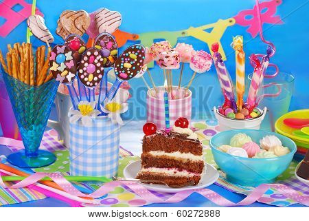 Birthday Party Table With Torte And  Sweets For Kids