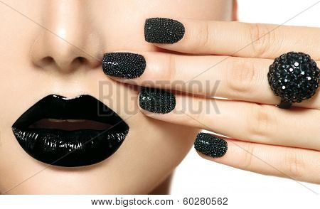 Beauty Black Caviar Manicure and Black Lips. Fashion Makeup and Manicure. Dark lipstick. Nail Art. Black ring accessories