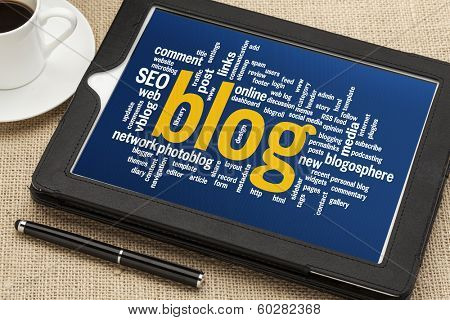 cloud of words related to blogging and blog design on a  digital tablet with cup of coffee