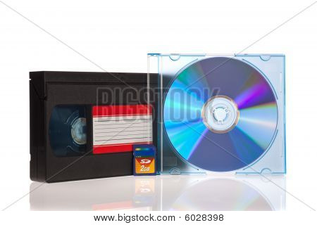 Old Video Cassette tape with a DVD disc and Flash Memory Card isolated on white background