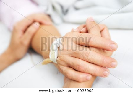 Daughter Holding Her Mother Hand In Hospital