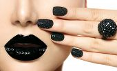 Beauty Black Caviar Manicure and Black Lips. Fashion Makeup and Manicure. Dark lipstick. Nail Art. Black ring accessories poster