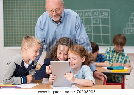 Cute Happy Young Children In Class At School