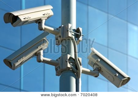 three security cameras