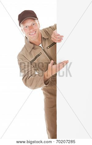 Smiling Manual Worker With Billboard