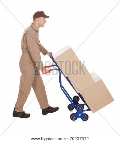 Delivery Postman Pushing Machine On Cart