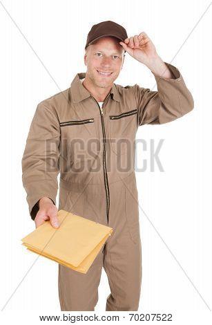 Postman Giving Envelopes Over White Background
