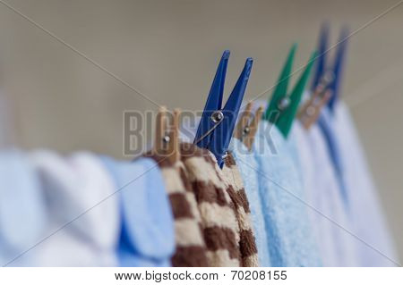 Clothespins Holding Clothes On The Clothesline