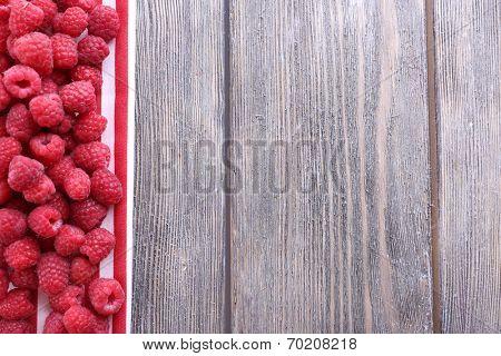 Ripe sweet raspberries on table close-up