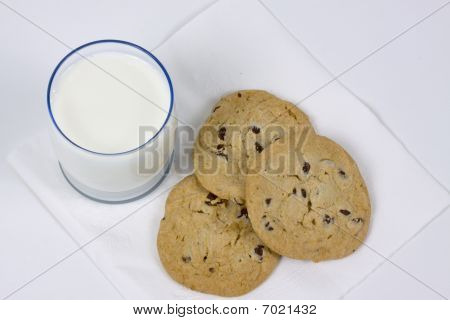 Three cookie and glass of milk