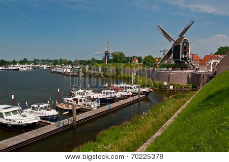 Boats in Harbor of Dutch Medieval Town Heusden