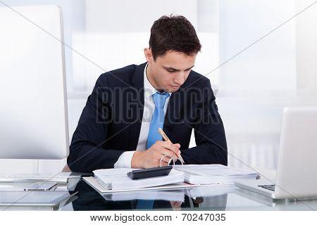 Businessman Computing Tax