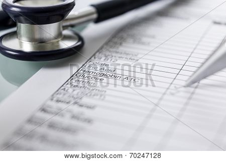 Stethoscope And A Blood Analytic Form