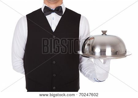 Waiter Holding Metal Cloche Lid Cover On Tray