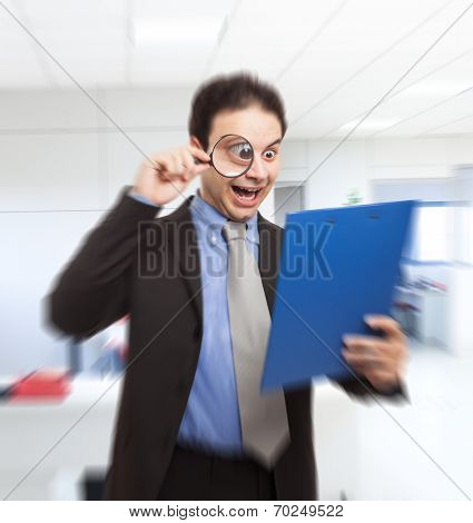 Shocked businessman reading a document