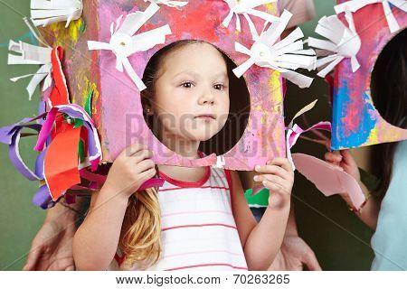 Girl with selfmade costume for carnival in a kindergarten
