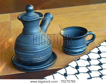 Ceramic Coffeepot And Cup.