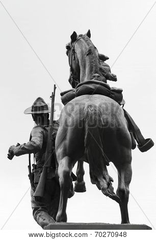 Monument of soldier and horse on white background