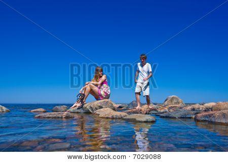 Couple On Beach Stones
