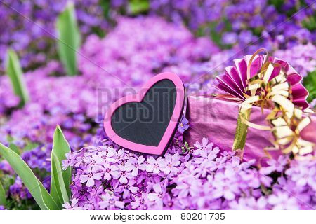Beautiful Sea Of Flowers With A Pink Heart And A Gift