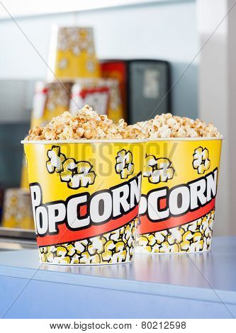Popcorn buckets on cinema concession counter