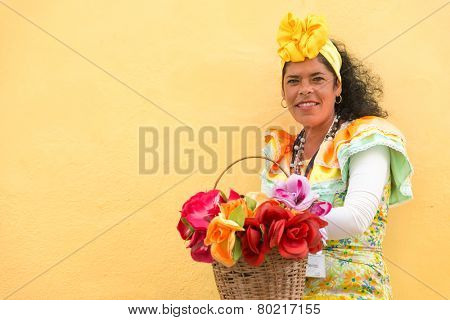 HAVANA, CUBA - JANUARY 8, 2015 : Young latin woman wearing a traditional dress in Old Havana