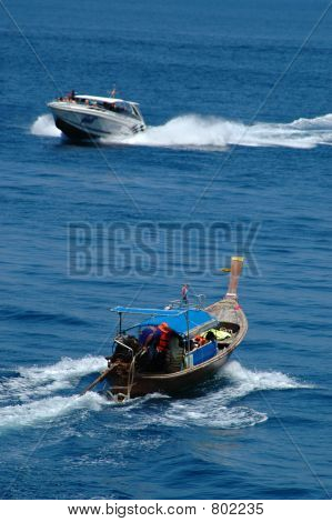 Tailboat and speedboat