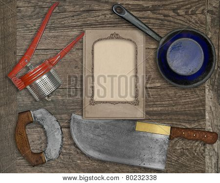 vintage kitchen knife and utensils over wooden board board, blank card for your text